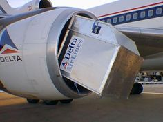 Delta Airlines Lockheed L-1011 cargo container into engine