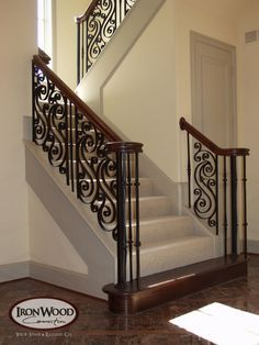This custom staircase design was created using our stock Gothic series balusters. This custom staircase design was created using our stock Gothic series balusters. This custom stai Staircase Railing Design, Wrought Iron Stair Railing, Home Stairs Design, Interior Stairs, Modern House Design, Iron Balusters, Wood Staircase, Railing Ideas, Banisters