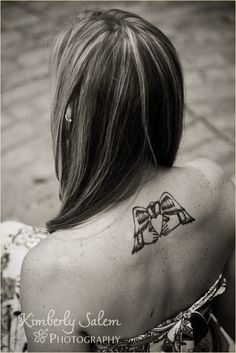 I want a tattoo like this, but on my lower back. Maybe....I'm sure I'll chicken out.