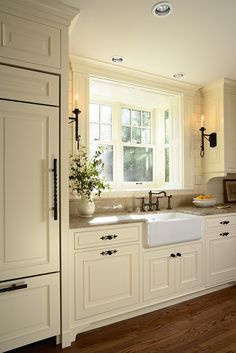 Tudor Style Homes Design, Pictures, Remodel, Decor and Ideas - page 4  Farmhouse sink...love it.  Dark pulls and oiled bronze faucet...who knew.  Awesome with style of house!  Subway tile.  Lighting interesting.