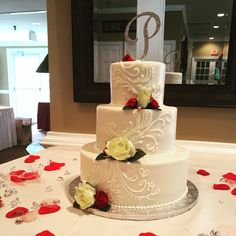 Lovely three tier round buttercream wedding cake with climbing scrollwork piping.