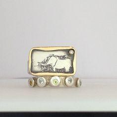 belle voir  elephant and topaz rings