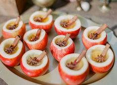 Apple cider in hollowed apples fall appetizer for rustic fall wedding