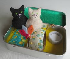 My chubby little cats measures 1 3/4 tall. Theyre carefully hand stitched and stuffed with polyester fiberfill. Embroidery floss was used for detailing. Included with my Altoid tin playset are sewn down cotton floral cozy beds with tiny french knots to look like buttons. Theres also a