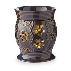 """Glimmer Fragrance Warmer Bloom 4.5"""" X 4.5"""" X 5.25"""" Bring a relaxing mood to the room and elegance to any home décor with the patent-pending Glimmer Fragrance Warmer. Designed to warm scented wax, the Glimmer Fragrance Warmer uses flickering LED lights (so there is never a bulb to change) to create the glow and ambiance of a burning candle. The warming dish sits on top of a warming plate to safely release the fragrance of scented wax into the room. Price: $28.95"""