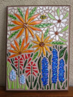 Handmade fused glass mosaic wall piece.  All the flowers and leaves are fused, the background is stained glass.