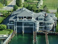 Million Dollar Boathouse. The fabulous home of John Winn, owner of Four Winns Yachts, rests on the shores of Round Lake in Charlevoix, Mich. Extravagance Unlimited: The Original Million Dollar Rooms Tour Future House, My House, Boat House, Opt In, Million Dollar Rooms, Boat Garage, Haus Am See, Waterfront Homes, Room Tour