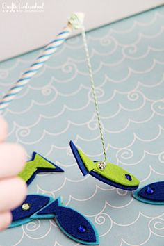 Magnetic Fishing Game for Kids Craft Tutoria  iman en un lapiz + un clip entre el velcro (o goma eva?)