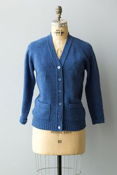 Vintage 1950s blue wool cardigan with button down front, pockets and ribbed hem.  ✂ ✂ ✂ M E A S U R E M E N T S ✂ ✂ ✂  fits like: medium bust: up to 40 waist: undefined sleeve length: 26 length: 25 brand/maker: Hazeldene Scotland condition: excellent to read about our condition standards and read our sizing guide: www.etsy.com/shop/GoldBanana/policy  ✶ visit the shop ✶  http://www.etsy.com/shop/GoldBanana _____________________  ✶ instagram @goldbananavi...