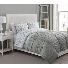 This comforter, quilt and sham set will look stunning on your bed. This Grace set features a soft, green, scroll pattern with a solid green rouched comforter that will dress up your room beautifully.
