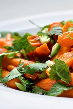 NYT Cooking: Carrots don't have to be boring or lackluster. Roasting, which captures the carrots' natural sweetness, is emphasized here with the aromatic sweetness of coconut oil. Cilantro, mint, jalapeño and lime ensure there nothing one-dimensional about this dish at all. Chop the herbs just before serving for the freshest flavor.