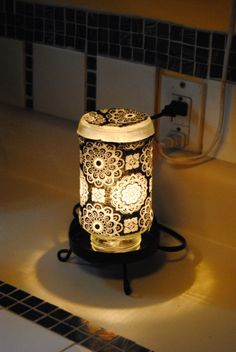Upcycled Spaghetti Jar Lamp Made with fabric and Mod Podge.