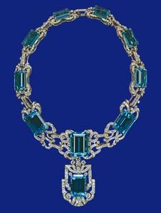 Aquamarine and diamond necklace - the necklace and matching earrings were a Coronation gift to The Queen from the President and People of Brazil in 1953 - perfectly matched stones are in diamond and platinum settings - original detachable pendant of the necklace was mounted in the centre of the tiara by Garrads and has been replaced by a smaller stone, also detachable.