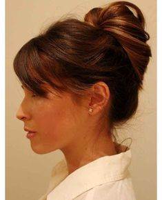 6. Your hair should now look like this. See how the top of the bun kind of goes off into a V? Gently pull those pieces forward if it happens to you and use bobby pins to secure.