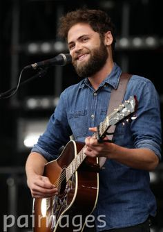 Mike Rosenberg of Passenger performing on the Main Stage at the Isle of Wight Festival, in Seaclose Park, Newport, Isle of Wight.