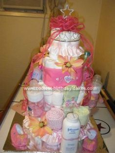 Homemade Pink and Orange Diaper Cake... This website is the Pinterest of diaper cake ideas