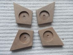 4 pieces dark walnut wooden deltoid/kite shaped pendant/brooch base for jewel making. In the centre of the pendant there is a 18 mm cabochon frame/cutout, which gives a more attractive look to the pendant. You can put a little picture, textil or napkin into the cutout. https://www.etsy.com/listing/232326652/new-4pc-unfinished-deltoid-shaped?ref=listing-shop-header-2
