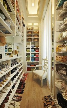 nice closet! I would do this in maybe darker wood tones, but I love the that there is a place for everything!
