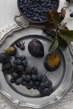 Blue berries, grapes and plums...on silver beautiful