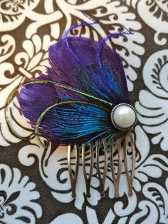 purple peacock feather hair comb