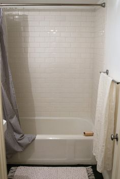 The Two-Week Budget Bath Remodel | Remodelista  For the shower surround, we chose basic white subway tile—to me, the best choice if you're on a budget. We used Daltile Rittenhouse Square Three-by-Six Modular Wall Tile in white; $22 for 12.5 square feet at Home Depot. (In addition to being affordable, it's made in the US.)