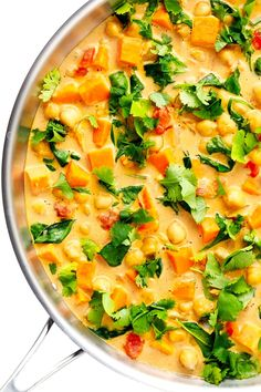 This delicious Sweet Potato Chickpea Coconut Curry recipe is super easy to make, naturally gluten-free, vegetarian and vegan, and it's simmered with tomatoes, garlic, ginger, spinach the coziest creamy coconut curry broth.Goes great with rice and/or naan bread, and tastes amazing for leftovers the next day! | gimmesomeoven.com #curry #healthy #vegetable #vegetarian #vegan #glutenfree #chickpea #sweetpotato #dinner #mealprep #indian
