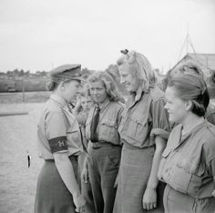 British Auxiliary Territorial Service Lance Corporal Jean Burck of New Malden, Surrey, England speaks to a group of female German POWs at Camp Vilvoorde. The camp was managed by British forces of the Army Group and housed over Axis POWs,. Military Women, Military Police, Luftwaffe, Lance Corporal, German Women, German Girls, Prisoners Of War, Go Camping, Camping Outdoors