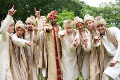 The groom wore a golden sherwani coat and matching turban featuring red details. His eight groomsmen also donned traditional Indian attire for the Hindu ceremony. #groomsmen #groomfashion Photography: Danny Weiss. Read More: http://www.insideweddings.com/weddings/traditional-hindu-ceremony-elegant-brooklyn-museum-reception/525/