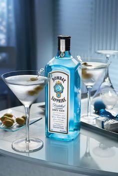 Bombay Sapphire Gin Martinis.. I'd need a cocktail shaker, some martini glasses and the one shot pourer that has part and half part tots.