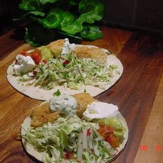 When we had our first fish tacos years ago, I knew I had to learn how to make them. I worked on the recipe until it was a close second to the version we got in Mexico. We love the fried fish, and the lime cream sauce, and the crunch of the crisp vegetables. Served on hot corn and flour tortillas with guacamole salsa and sour cream.  This is just about as good as it gets!  Enjoy!    The photo is my own, and so is this humble recipe.