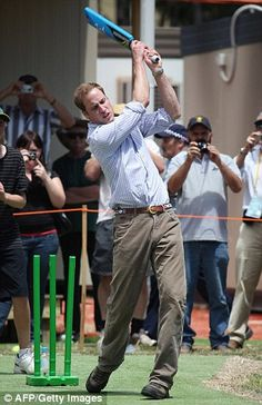 Britain's Prince William playing cricket