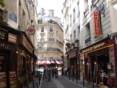 Latin Quarter. district for all the young, hip, intellectuals.  Good eats and shopping. I bought all my scarfs around there, maybe you can find some fabulous new Parisian scarfs to bring home :)