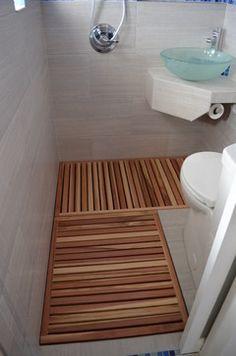 Joe Statwick's Thai style micro-bathroom addition - wood floor, smartly located TP roll!