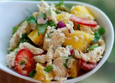 Mango Chicken Salad    Serves 2    8 0unces roasted chicken breast, torn or cut into bite size pieces  1/2 fresh mango, cubed (see Cook's note)  1/2 large fresh red jalapeno, thinly sliced  1/4 cup chopped fresh cilantro  1/8 cup diced fresh red onion  fresh cracked pepper  Kosher salt    Dressing:  1 Tablespoon good mayonnaise (I used Best)  1 teaspoon Dijon mustard (I used Maille)  1 teaspoon O Citrus Champagne Vinegar