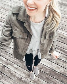 Military jacket // jacket // Spring jacket // peplum top // peplum // distressed jeans // black jeans // sneakers // grey sneakers // Spring shoes // earrings // tassel earrings // Spring outfits // casual outfits // outfit ideas
