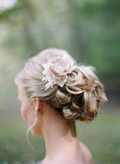 floral pinned wedding updo hairstyle with flowers