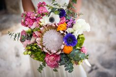 The bride honored her South African heritage with a King Protea bouquet {Photo by Julia Saad Photography via Project Wedding}