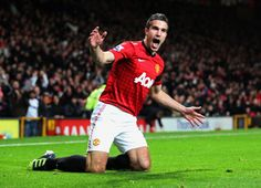 Robin van Persie of Manchester United celebrates  as he scores their first goal during the Barclays Premier League match between Manchester United and West Ham United at Old Trafford on November 28, 2012 in Manchester, England