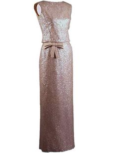 The dress worn by Jackie Kennedy as First Lady at the famous dinner at Schönbrunn Palace in Vienna, June 3, 1961, hosted by the Austrian president, where she dazzled Soviet Premier Nikita Khrushchev in an exquisite shell-pink, Oleg Cassini silk-georgette chiffon evening dress embroidered with sequins.