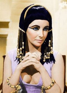 "Elizabeth Taylor as 'Cleopatra'. The truly idiotic quotes from Cleopatra, the 1963 movie; Cleopatra (Liz Taylor) seducing Caesar (Rex Harrison):""My breasts are full of love and life. My hips are round and well apart. Such women, they say, have sons"". Elizabeth Taylor Cleopatra, Brigitte Bardot, Classic Hollywood, Old Hollywood, Violet Eyes, Blue Eyes, Actrices Hollywood, Elisabeth, Marlene Dietrich"