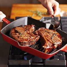 Bone in Rib-eye Steaks simply cooked with thyme, salt and pepper in a grill pan.