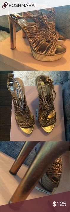 Miu Miu espadrilles. Super fun and sexy Love this shoe. Metallic gold. Espadrilles. Perfect for summer. Platform makes it super comfy. Heels a bit scuffed otherwise in excellent condition. Size 37. Narrow. Heel height: 5 inches. Platform height 1.5 inches. Miu Miu Shoes Espadrilles