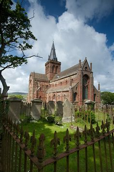 KIRKWALL, ORKNEY, SCOTLAND, UK -- St. Magnus Cathedral towers over the city of Kirkwall in Orkney, Scotland. Built to honor the Viking Earl of Orkney, St. Magnus.