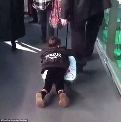 'She won't let it gooooo!' Kim Kardashian posts hilarious video of daughter North West clinging on to her Frozen suitcase