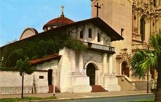 Vintage postcard showing the exterior of Mission Dolores with its red tiled roofs and its exterior p