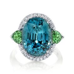 Super fresh summer cocktail ring featuring a beautiful blue zircon accented by tsavorite and diamonds.  #omiprive