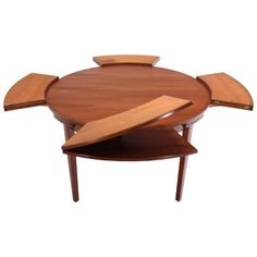 rare Danish modern teak round expandable top dining table