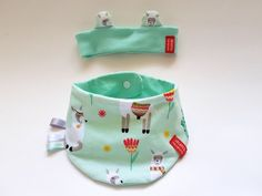 Are you in search of an unique and original gift for a baby or a kid? You've come to the right place!  This gift set consisting of reversible - two sided bandana bib and headband is perfect for your favorite little one's fashionable needs. Both items are one size and will accompany the first baby's year. Each piece is One Of A Kind (OOAK). High quality eco-certified baby-friendly cotton with great love for detail. Handmade in Vienna, Austria/European Union.
