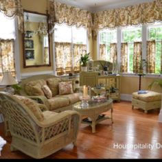 Great sunroom idea. Don't care for the curtains though