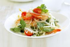 Green papaya salad with chilli prawns. Add bright tropical flavours to your salad with papaya.